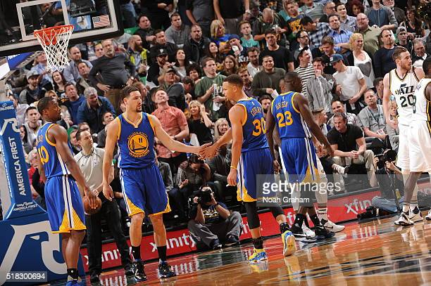 Stephen Curry of the Golden State Warriors high fives Klay Thompson of the Golden State Warriors during the game against the Utah Jazz on March 30...