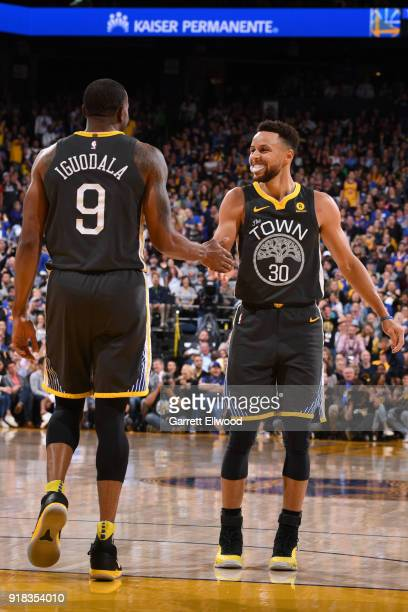 Stephen Curry of the Golden State Warriors highfives Andre Iguodala of the Golden State Warriors during the game against the San Antonio Spurs on...