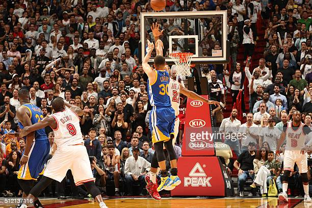 Stephen Curry of the Golden State Warriors hits a three point shot against the Miami Heat on February 24 2016 at American Airlines Arena in Miami...
