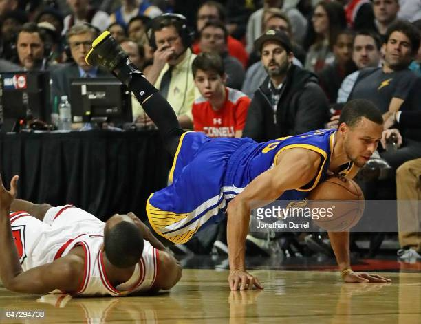 Stephen Curry of the Golden State Warriors hits the floor after being fouled by Rajon Rondo of the Chicago Bulls at the United Center on March 2 2017...