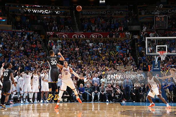 Stephen Curry of the Golden State Warriors hits the winning shot against Andre Roberson of the Oklahoma City Thunder on February 27, 2016 at...
