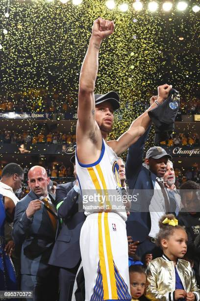 Stephen Curry of the Golden State Warriors holds his arms in the air and celebrates after winning Game Five of the 2017 NBA Finals against the...