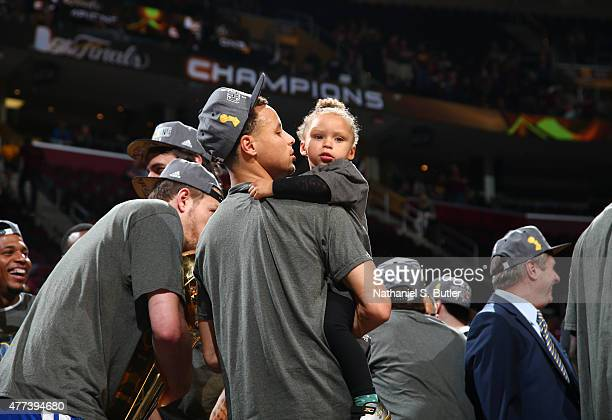 Stephen Curry of the Golden State Warriors holds his daughter Riley Curry after the Golden State Warriors win Game Six of the 2015 NBA Finals at The...