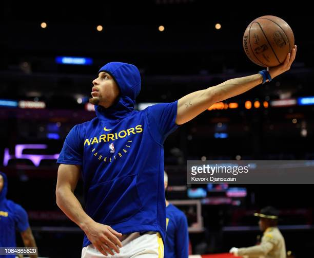 Stephen Curry of the Golden State Warriors holds the ball during warms up before the start of a basketball game against Los Angeles Clippers at...