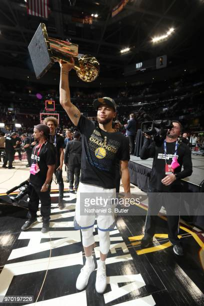 Stephen Curry of the Golden State Warriors holds the Larry O'Brien Championship Trophy after Game Four of the 2018 NBA Finals against the Cleveland...