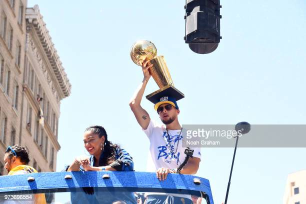 Stephen Curry of the Golden State Warriors holds up the Larry O'Brien Championship Trophy during the Golden State Warriors Victory Parade on June 12...