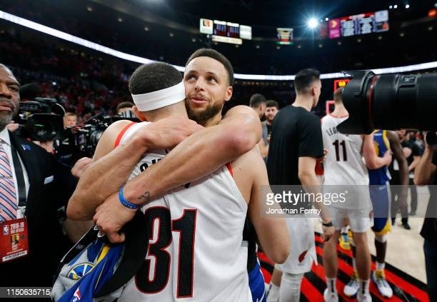 Stephen Curry of the Golden State Warriors hugs brother Seth Curry of the Portland Trail Blazers after defeating the Trail Blazers 119-117 during...