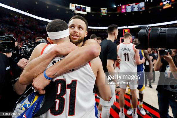 Stephen Curry of the Golden State Warriors hugs brother Seth Curry of the Portland Trail Blazers after defeating the Trail Blazers 119117 during...