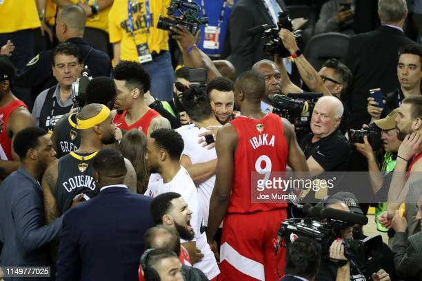 Stephen Curry of the Golden State Warriors hugs Jeremy Lin of the Toronto Raptors after the Toronto Raptors win the game and become the 2019 NBA...