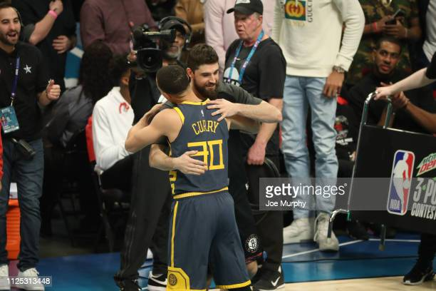 Stephen Curry of the Golden State Warriors hugs Joe Harris of the Brooklyn Nets during the 2019 Mtn Dew 3Point Contest as part of State Farm AllStar...