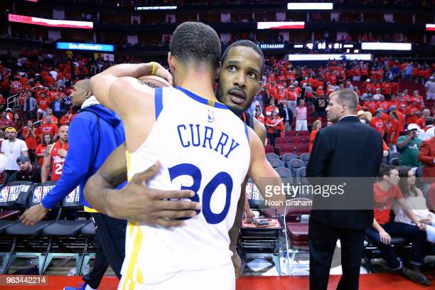 Stephen Curry of the Golden State Warriors hugs Trevor Ariza of the Houston Rockets after Game Seven of the Western Conference Finals during the 2018...