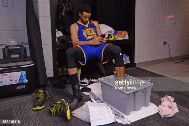 Stephen Curry of the Golden State Warriors ices up in the locker room after Game Three of the Western Conference Finals against the San Antonio Spurs...