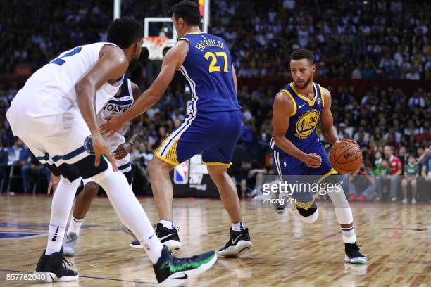 Stephen Curry of the Golden State Warriors in action as Zaza Pachulia of the Golden State Warriors picks during the game between the Minnesota...