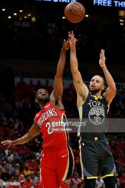 Stephen Curry of the Golden State Warriors is blocked by Ian Clark of the New Orleans Pelicans during the second half of Game Three of the Western...