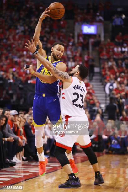 Stephen Curry of the Golden State Warriors is defended by Fred VanVleet of the Toronto Raptors in the first half during Game Two of the 2019 NBA...