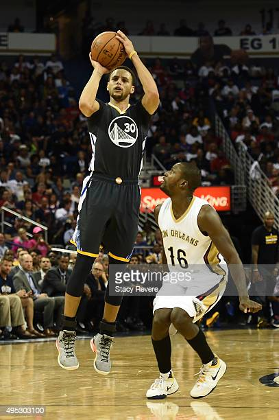 Stephen Curry of the Golden State Warriors is defended by Toney Douglas of the New Orleans Pelicans at the Smoothie King Center on October 31 2015 in...