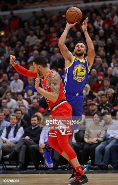 Stephen Curry of the Golden State Warriors is foued while shooting by Denzel Valentine of the Chicago Bulls at the United Center on January 17 2018...