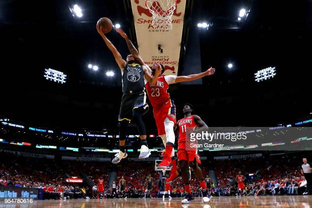 Stephen Curry of the Golden State Warriors is fouled by Anthony Davis of the New Orleans Pelicans during the second half of Game Three of the Western...