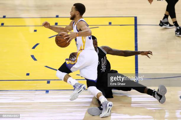Stephen Curry of the Golden State Warriors is fouled by Dewayne Dedmon of the San Antonio Spurs during Game Two of the NBA Western Conference Finals...