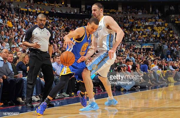 Stephen Curry of the Golden State Warriors is fouled by Kosta Koufos of the Denver Nuggets as referee Tony Brothers oversees the action during Game...