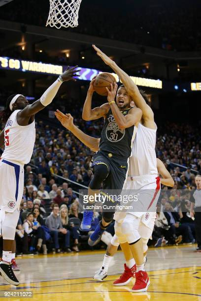 Stephen Curry of the Golden State Warriors is fouled while shooting by Boban Marjanovic of the Los Angeles Clippers at ORACLE Arena on February 22...