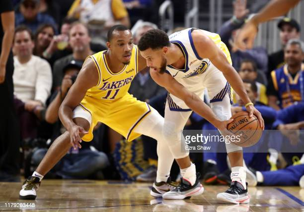 Stephen Curry of the Golden State Warriors is guarded by Avery Bradley of the Los Angeles Lakers at Chase Center on October 05 2019 in San Francisco...