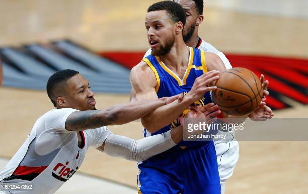 Stephen Curry of the Golden State Warriors is guarded by Damian Lillard of the Portland Trail Blazers during Game Four of the Western Conference...