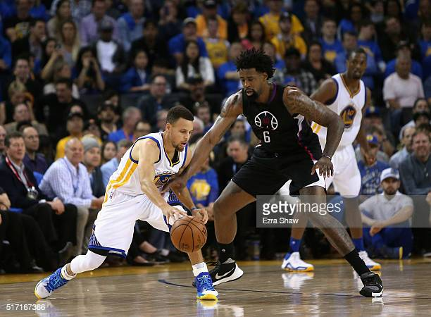 Stephen Curry of the Golden State Warriors is guarded by DeAndre Jordan of the Los Angeles Clippers at ORACLE Arena on March 23 2016 in Oakland...