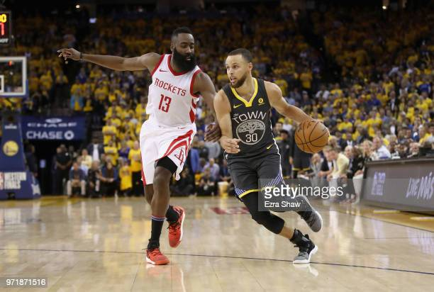 Stephen Curry of the Golden State Warriors is guarded by James Harden of the Houston Rockets during Game 4 of the Western Conference Finals at ORACLE...