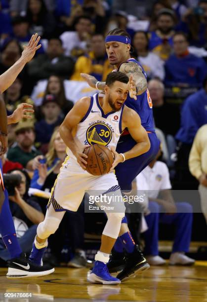 Stephen Curry of the Golden State Warriors is guarded by Michael Beasley of the New York Knicks at ORACLE Arena on January 23 2018 in Oakland...