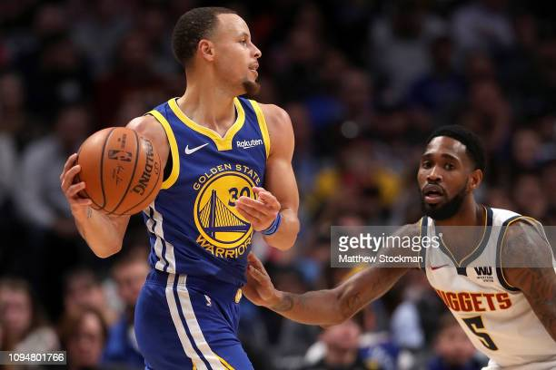 Stephen Curry of the Golden State Warriors is guarded by Will Barton of the Denver Nuggets at the Pepsi Center on January 15 2019 in Denver Colorado...