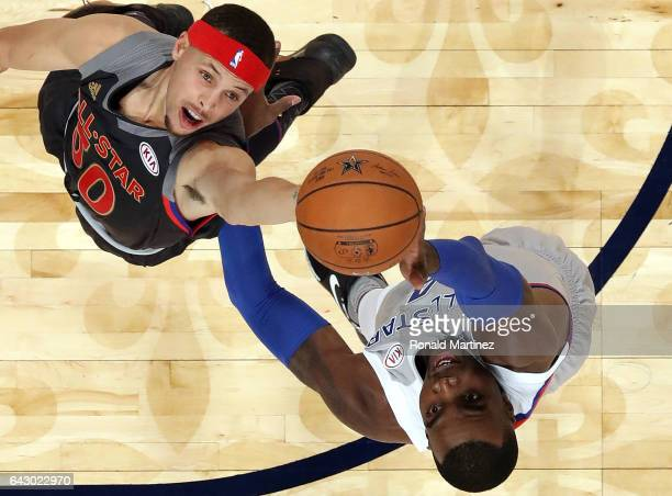 Stephen Curry of the Golden State Warriors jumps for a rebound with Paul Millsap of the Atlanta Hawks during 2017 NBA AllStar Game at Smoothie King...