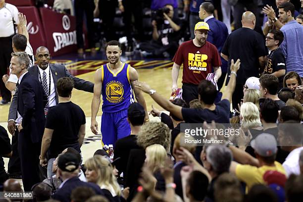 Stephen Curry of the Golden State Warriors leaves the court after fouling out and being ejected during the fourth quarter against the Cleveland...