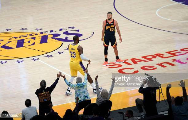 Stephen Curry of the Golden State Warriors looks at LeBron James of the Los Angeles Lakers after scoring the game winning three point basket against...
