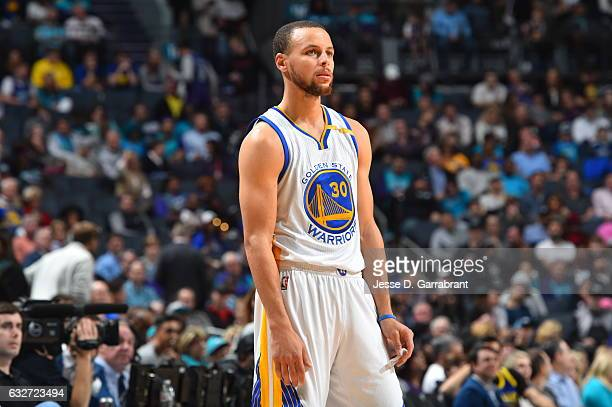 Stephen Curry of the Golden State Warriors looks on against the Charlotte Hornets at Spectrum Center on January 25 2017 in Charlotte North Carolina...