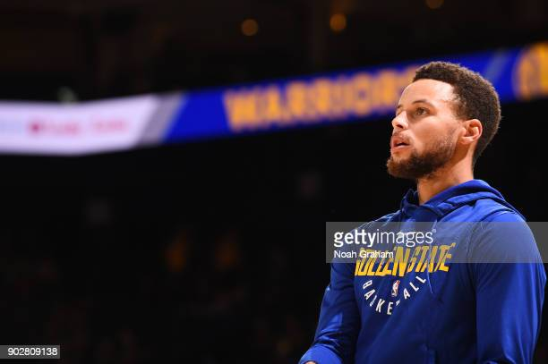 Stephen Curry of the Golden State Warriors looks on before the game against the Denver Nuggets on January 8 2018 at ORACLE Arena in Oakland...
