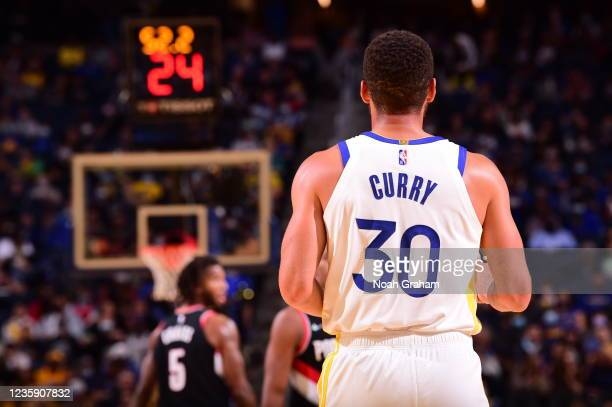 Stephen Curry of the Golden State Warriors looks on during a preseason game against the Portland Trail Blazers on October 15, 2021 at Chase Center in...