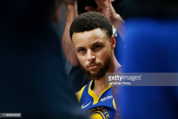 Stephen Curry of the Golden State Warriors looks on during a timeout in game four of the NBA Western Conference Finals against the Portland Trail...