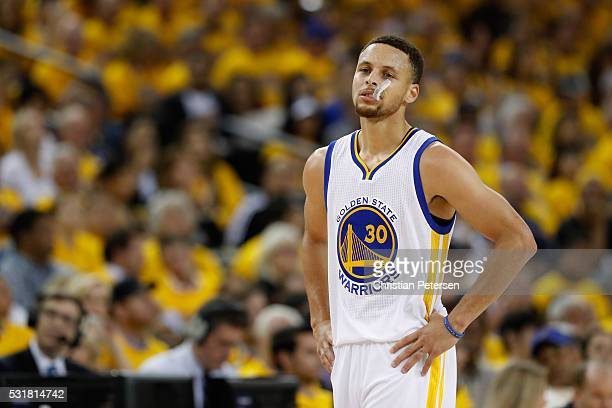 Stephen Curry of the Golden State Warriors looks on during game one of the NBA Western Conference Finals against the Oklahoma City Thunder at ORACLE...