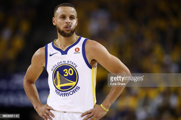 Stephen Curry of the Golden State Warriors looks on during Game Three of the Western Conference Finals of the 2018 NBA Playoffs against the Houston...
