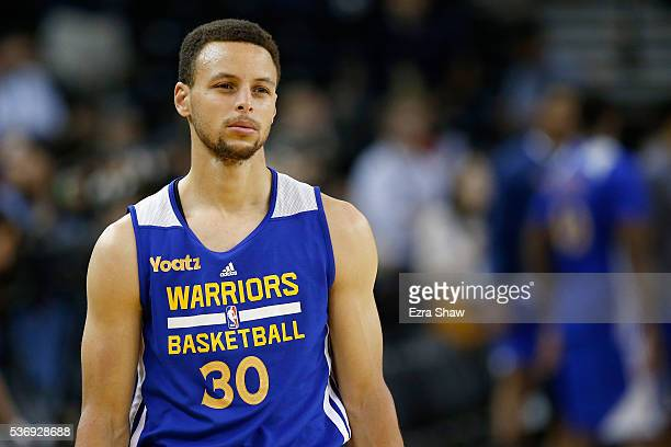 Stephen Curry of the Golden State Warriors looks on during practice before the 2016 NBA Finals at ORACLE Arena on June 1 2016 in Oakland California...