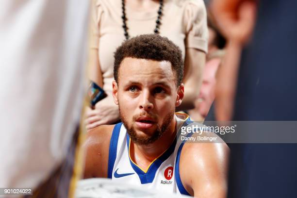 Stephen Curry of the Golden State Warriors looks on during the game against the Dallas Mavericks on January 3 2018 at the American Airlines Center in...
