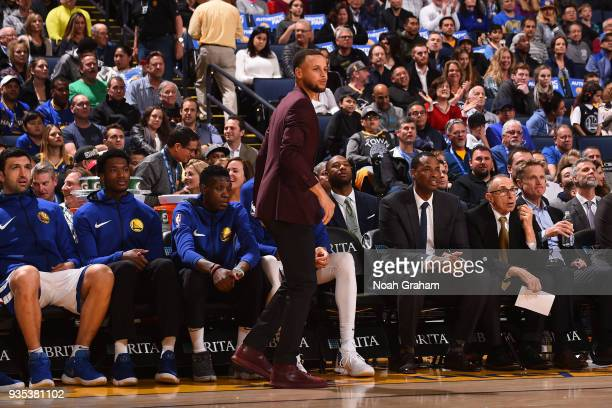 Stephen Curry of the Golden State Warriors looks on during the game against the Sacramento Kings on March 16 2018 at ORACLE Arena in Oakland...