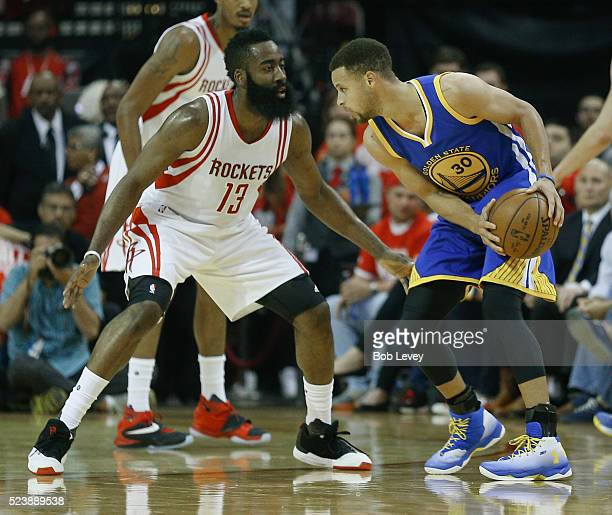 Stephen Curry of the Golden State Warriors looks to drive on James Harden of the Houston Rockets at Toyota Center on April 24 2016 in Houston Texas...