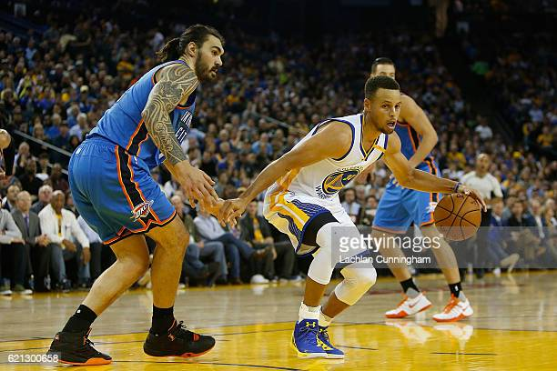 Stephen Curry of the Golden State Warriors looks to get past Steven Adams of the Oklahoma City Thunder at ORACLE Arena on November 3 2016 in Oakland...