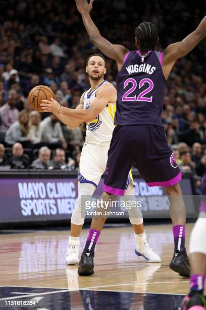 Stephen Curry of the Golden State Warriors looks to pass against the Minnesota Timberwolves on March 19 2019 at Target Center in Minneapolis...