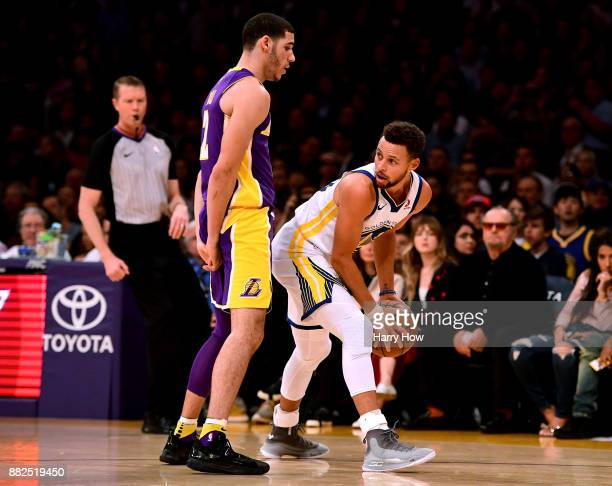 Stephen Curry of the Golden State Warriors looks to pass around Lonzo Ball of the Los Angeles Lakers during the first half at Staples Center on...