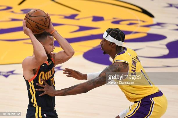 Stephen Curry of the Golden State Warriors looks to pass as Kentavious Caldwell-Pope of the Los Angeles Lakers defends during the first half of an...