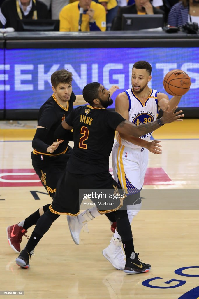 Stephen Curry #30 of the Golden State Warriors looks to pass the ball against Kyrie Irving #2 and Kyle Korver #26 of the Cleveland Cavaliers in Game 5 of the 2017 NBA Finals at ORACLE Arena on June 12, 2017 in Oakland, California.