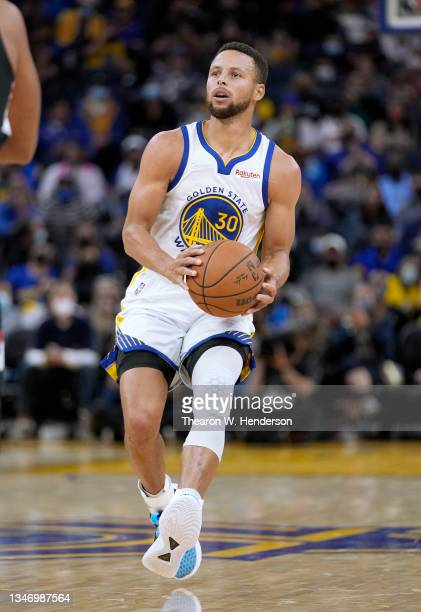 Stephen Curry of the Golden State Warriors looks to shoot a three point shot against the Portland Trail Blazers during the second half of their game...